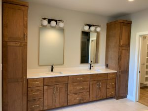 Dual bathroom vanity in custom home with gold finishings