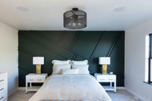 Dark Green accent wall in bedroom in Custom Home Fargo, ND