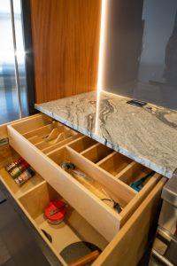 Custom Storage in Modern Kitchen with Granite Countertops