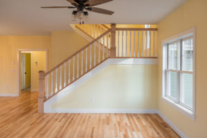 Oak Hardwood floors and custom staircase built by custom Home Builder