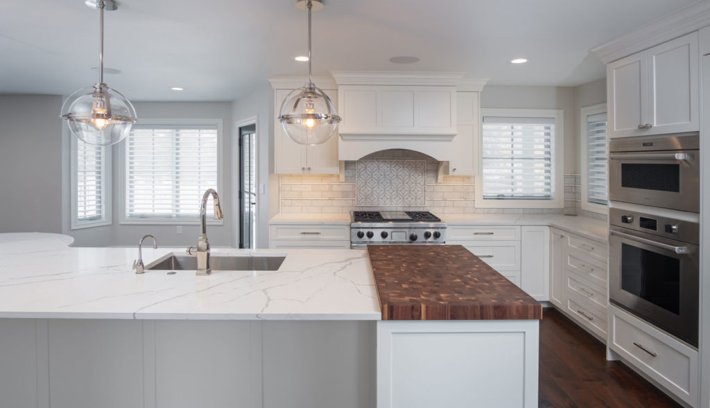 Custom granite kitchen counter top with butcher block end cap in Radiant Homes custom home