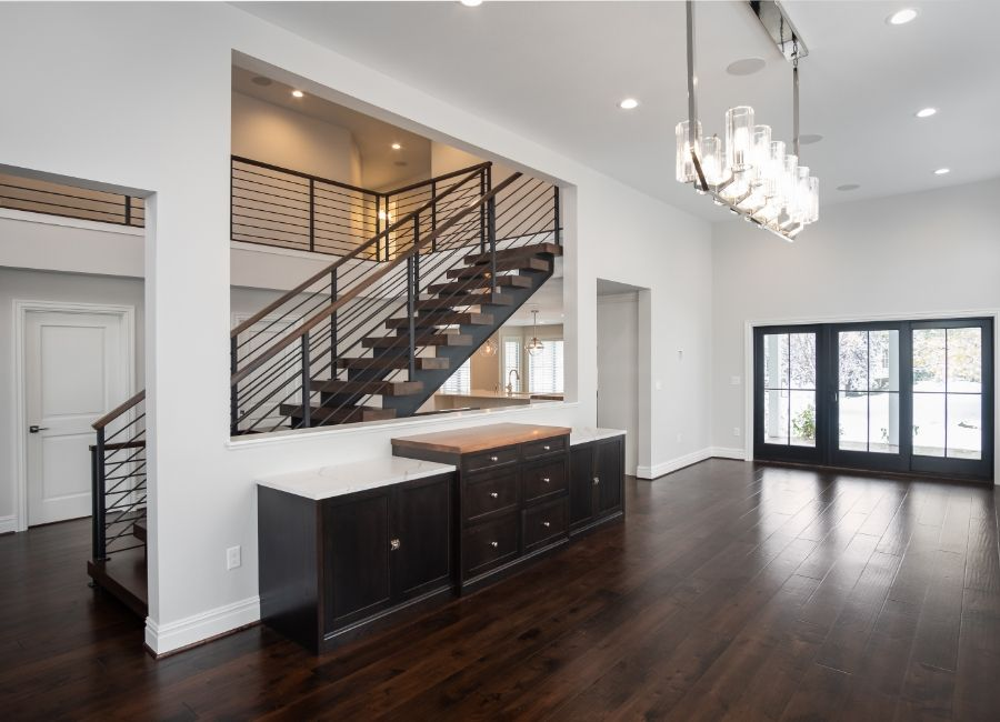 Remodeled Entryway with walnut staircase