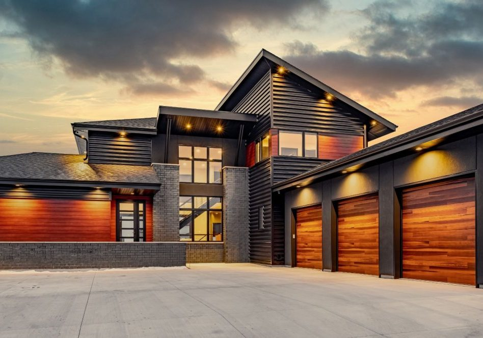 Striking Contemporary Home with three stall garage and peaked roof